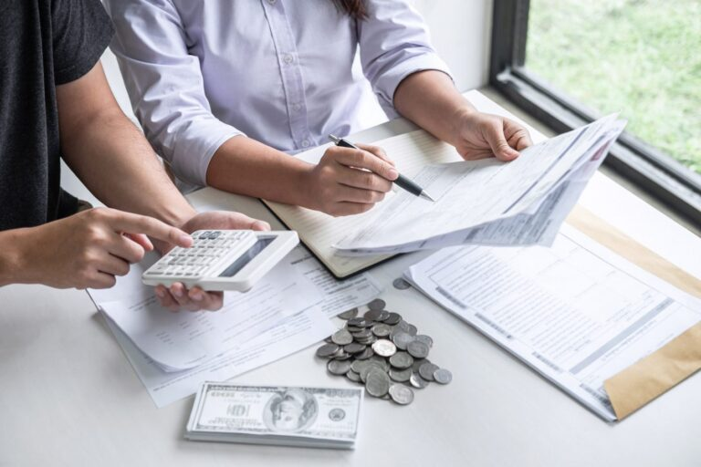 Images of Husband and wife using calculator to calculating expenditure receipt bills of various